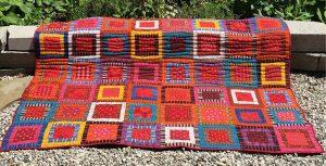 photo of a brightly coloured chakalaka throw made from shweshwe fabric