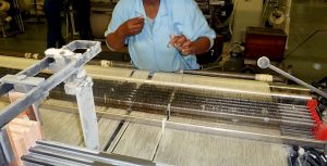 photo of a working loom in the da gama factory in south africa