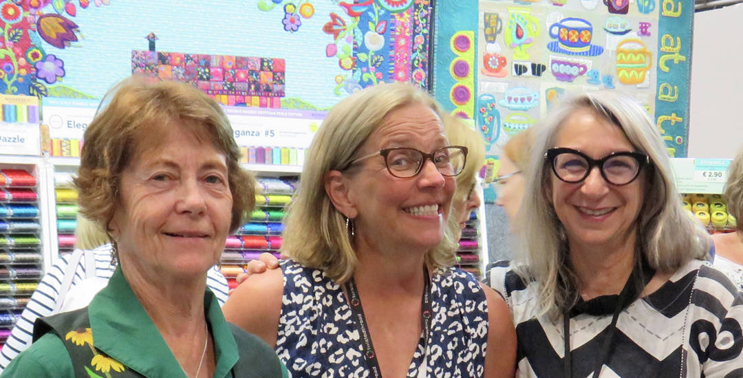 photo of rose parr, kathy tidswell and bernadette kent at the uk festival of quilts