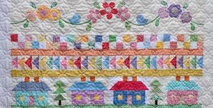 photo of several rows of the Block of the Month quilt