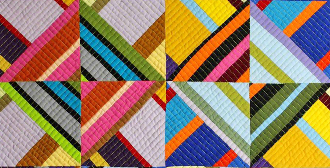 photo of Four Eyes quilt by Anne Rayner-Gould
