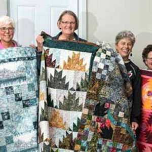 photo of the BGs with their Book Club Challenge quilts