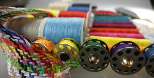 photo of colourful spools of thread and bobbins